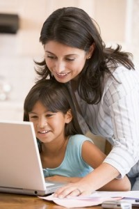 Woman and daughter at computer